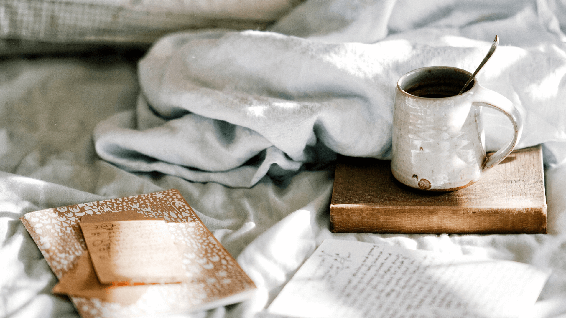 bed in the morning with coffee and journal