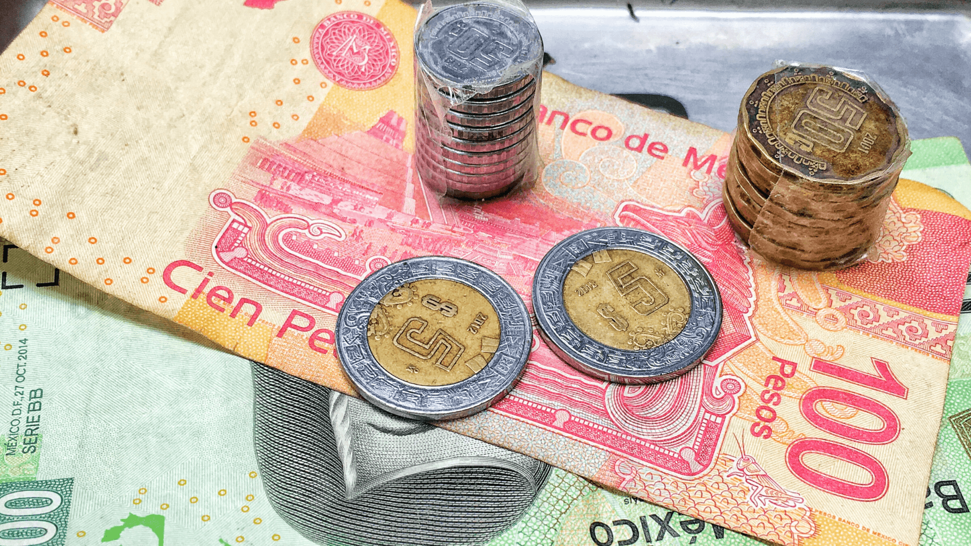 Mexican peso bills and coins